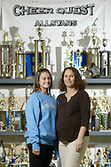 Cherie Ramsey, right, who runs Cheer Quest in Pine Bush, poses for a portrait with her daughter Cherie Lee Passalaqua, who is a cheerleader at Southern Connecticut State University, on Dec. 27, 2006, in Pine Bush. The trophies in the background were from competitions involving Cheer Quest or the Pine Bush High School cheerleaders.