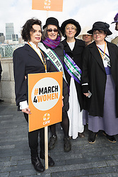 © Licensed to London News Pictures. 05/03/2017. LONDON, UK.  Bianca Jagger, with Helen Pankhurst, the great granddaughter of Suffragette, Emmeline Pankhurst and feminist activists take part in the March4Women, organised by CARE International to mark International Women's Day. The Women's Day March begins at The Scoop near City Hall, before proceeding over Tower Bridge and finishing at the Tower of London. Photo credit: Vickie Flores/LNP