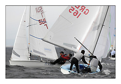470 Class European Championships Largs - Day 1.Racing in grey and variable conditions on the Clyde...GRE165, Panagiotis KAMPOURIDIS, Efstathios PAPADOPOULOS, Yaucht Club Of Greece.SUI7, Olivier GREMAUD, Adrien GREMAUD, Club Nautique Morgien
