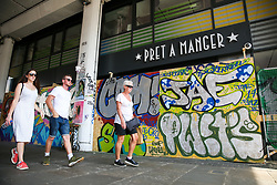 © Licensed to London News Pictures. 24/08/2019. London, UK. People walk past Pret A Manger which is boarded up ahead of the 2019 Notting Hill Carnival wwhich takes place this weekend and on bank holiday Monday. Up to 1 million people are expected to attend the biggest street party in Europe. Photo credit: Dinendra Haria/LNP