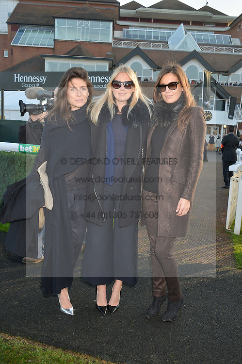 Left to right, WALLIS DOLAN, MARISSA MONTGOMERY and AMANDA FERRY at the 2014 Hennessy Gold Cup at Newbury Racecourse, Newbury, Berkshire on 29th November 2014.  The Gold Cup was won by Many Clouds ridden by Leighton Aspell.