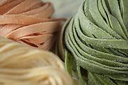 Studio photo shoot for Eataly Boston's fresh pasta. Spinach tagliatelle, tomato tagliatelle, and tagliolini