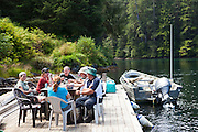 Hikers relax and lunch at the Nitinat Narrows ferry station, West Coast Trail, British Columbia, Canada.