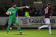 AFC Wimbledon goalkeeper Tom King (1) pointing during the EFL Carabao Cup 2nd round match between AFC Wimbledon and West Ham United at the Cherry Red Records Stadium, Kingston, England on 28 August 2018.