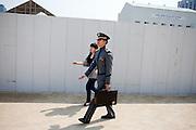 Soldier of the Korean army with a suitcase at Gwanghwamun of Gyeongbokgung Palace. / Seoul, South Korea, Republic of Korea, KOR, 25 April 2010.