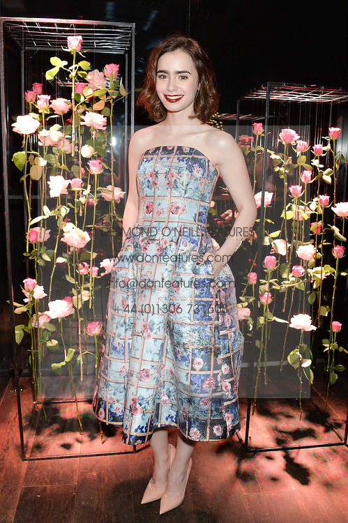 LILY COLLINS at the Lancôme pre BAFTA party held at The London Edition, 10 Berners Street, London on 14th February 2014.