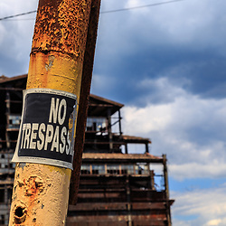 Mahanoy City, PA - June 22, 2016:  No trespassing signs at a deteriorating coal breaker built and used to process anthracite.