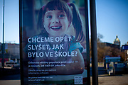 "A public advertisement for . vaccination by the city of Prague. ""Do we want to know again how it was at school?"" On March 1st, 2021 the state of emergency in the Czech Republic was reinstalled because of fast increasing numbers in infections. The lockdown was reinstated and the restriction of the free movement of people has taken effect. Currently, the country remains at the highest stage of the anti-epidemiological system and the newly imposed restriction will last at least three weeks to curb the epidemic."