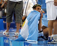 29/08/04 - ATHENS  - GREECE -  - BASKETBALL SEMIFINAL MATCH   - Indoor Olympic Stadium - <br />ARGENTINA win over ITALY and win the GOLD MEDAL<br />Argentine celebration after win the match.<br />Here EMANUEL GINOBILI - <br />© Gabriel Piko / Argenpress.com / Piko-Press