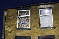 © Licensed to London News Pictures . 08/09/2016 . Rochdale , UK . First floor windows covered over at a house at the junction of Rooley Moor Road and Preston Street in Spotland as a 25 year old man has been arrested for murder following the death of an 8 month old baby boy on Tuesday 6th September 2016 . A 24 year old woman is also in custody . Photo credit: Joel Goodman/LNP