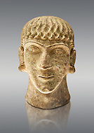 First half of the 6th century B.C Etruscan clay head of a young man made in Chiusi, inv 94612, National Archaeological Museum Florence, Italy , against grey .<br /> <br /> If you prefer to buy from our ALAMY PHOTO LIBRARY  Collection visit : https://www.alamy.com/portfolio/paul-williams-funkystock - Scroll down and type - Etruscan Florence - into LOWER search box. (TIP - Refine search by adding a background colour as well).<br /> <br /> Visit our ETRUSCAN PHOTO COLLECTIONS for more photos to download or buy as wall art prints https://funkystock.photoshelter.com/gallery-collection/Pictures-Images-of-Etruscan-Historic-Sites-Art-Artefacts-Antiquities/C0000GgxRXWVMLyc