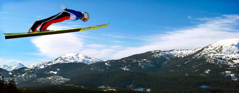 Canada, Whistler, 19-02-2010.<br /> Olympische Winterspelen.<br /> Skispringen, Individueel Kwalificatieronde.<br /> Sebastian Colloredo uit Italie tijdens zijn sprong.<br /> Foto: Klaas Jan van der Weij