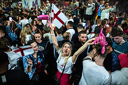 © Licensed to London News Pictures . 11/07/2021. Manchester, UK. England football fans are seen reacting in Stevenson Square in Manchester City Centre after England lose on penalties after extra time in the European Cup Final match between England and Italy , which was played at Wembley Stadium. Photo credit: Joel Goodman/LNP