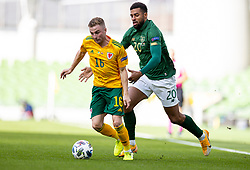 DUBLIN, REPUBLIC OF IRELAND - Sunday, October 11, 2020: Wales' Joseff Morrell (L) is pulled back by Republic of Ireland's Cyrus Christie during the UEFA Nations League Group Stage League B Group 4 match between Republic of Ireland and Wales at the Aviva Stadium. The game ended in a 0-0 draw. (Pic by David Rawcliffe/Propaganda)