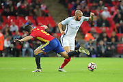 England attacker Andros Townsend (17) dribbling past Spain midfielder Koke (08) during the Friendly match between England and Spain at Wembley Stadium, London, England on 15 November 2016. Photo by Matthew Redman.