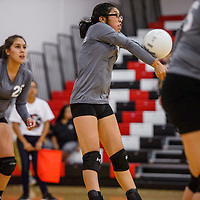 Miyamura Patriot Ashley Hildreth (11) bumps back a serve from the Grants Pirates Thursday at Grants High School.