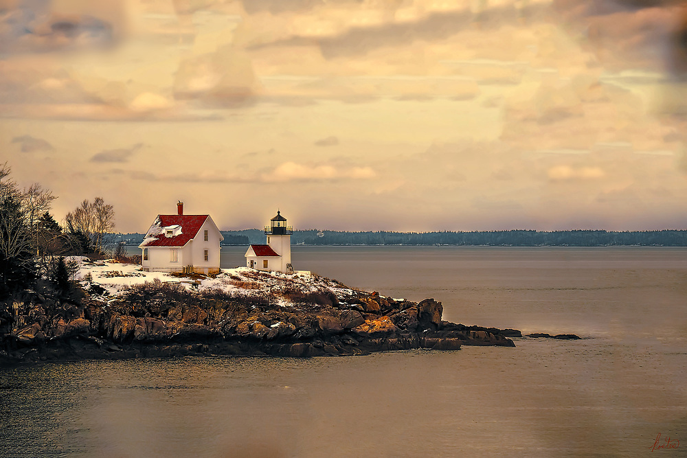 This is the Curtis Island Lighthouse in Camden, Maine. It's sunset, late winter with just a bit of snow left on the ground and the roof of the out building. The sky is full of broken clouds.