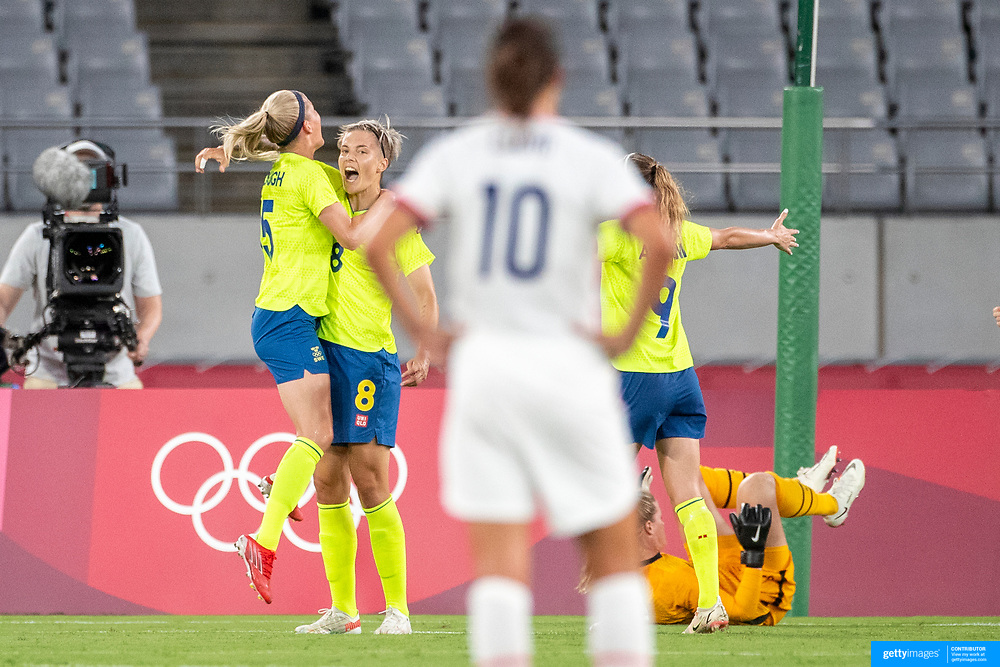 TOKYO, JAPAN - JULY 21:   Carli Lloyd #10 of the United States watches  Lina Hurtig, 8, of Sweden celebrate with team mates after scoring her sides third goal during the USA V Sweden group G women's football match at Tokyo Stadium during the Tokyo 2020 Olympic Games on July 21, 2021 in Tokyo, Japan. (Photo by Tim Clayton/Corbis via Getty Images)