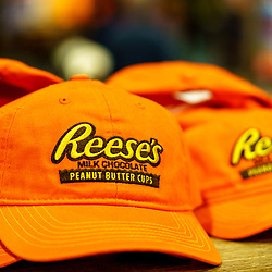 Hershey, PA / USA - November 26, 2019:  Reese's Peanut Butter Cups branded caps are on display and for sale in Hershey's Chocolate World.