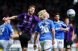 Matt Harrold (ENG) of Bristol Rovers heads the ball past Jack Whatmough (ENG) of Portsmouth - Photo mandatory by-line: Rogan Thomson/JMP - 07966 386802 - 19/04/2014 - SPORT - FOOTBALL - Fratton Park, Portsmouth - Portsmouth FC v Bristol Rovers - Sky Bet Football League 2.