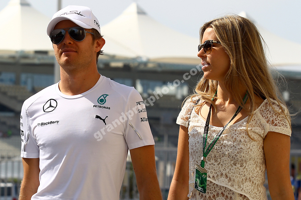 Nico and Vivian Rosberg (Mercedes) with sunglasses at the 2014 Abu Dhabi Grand Prix at Yas Marina Circuit. Photo: Grand Prix Photo