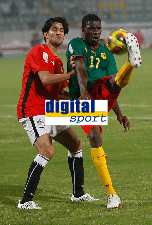 Photo: Steve Bond/Richard Lane Photography.<br />Egypt v Cameroun. Africa Cup of Nations. 22/01/2008. Mahmoud Fathalla (L) cannot stop Mohamadou Idrissou (R) getting a cross in