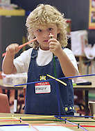 TOM BUSHEY/The Record<br />Ashley Drew Mullane concentrates on her creation during her first day of kindergarten yesterday at George Grant Mason Elementary and Middle School in Tuxedo.<br />Sept. 5, 2001.
