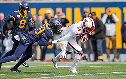 Nov 9, 2019; Morgantown, WV, USA; Texas Tech Red Raiders wide receiver Erik Ezukanma (84) is tackled by West Virginia Mountaineers cornerback Keith Washington Jr. (28) during the first quarter at Mountaineer Field at Milan Puskar Stadium. Mandatory Credit: Ben Queen-USA TODAY Sports