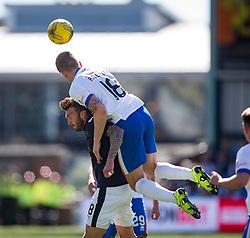 Kilmarnock's Ashcroft over Falkirk's Lee Miller. Kilmarnock 4 v 0 Falkirk, second leg of the Scottish Premiership play-off final.