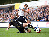 Photo: Chris Ratcliffe.<br /> Tottenham Hotspur v Portsmouth. The Barclays Premiership. 01/10/2006.<br /> Sean Davis (L) of Portsmouth clashes with Hossam Ghaly of Spurs.