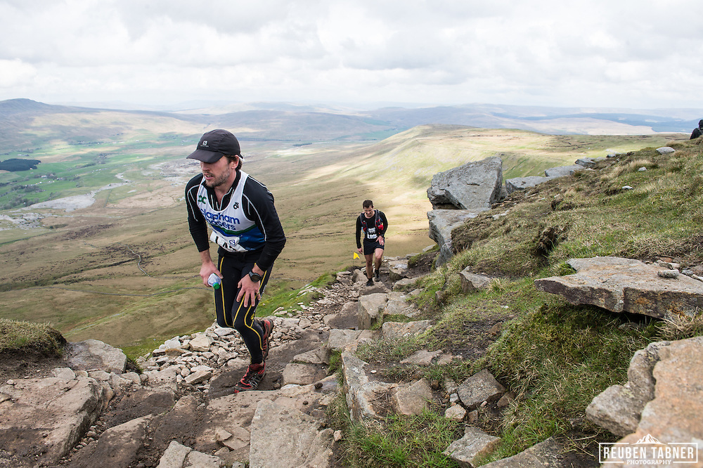 Tobias Mews climbs the last section before reaching the plateau of Ingleborough in the Yorkshire Dales during the 60th Yorkshire Three Peaks Race.
