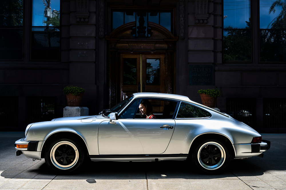 """Lancaster, Pennsylvania - June 09, 2019: Caroline Ecklin with """"Sally"""" her 1980 Porsche 911 outside the Stevens School apartments in Lancaster, Pa., Sunday June 9, 2019. The 27-year-old car restoration garage manager names her cars, and this one is after the Disney Pixar Porsche character in the movie """"Cars.""""<br /> <br /> <br /> CREDIT: Matt Roth for The Wall Street Journal"""