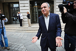 """Franco-Lebanese Ziad Takieddine, flanked by his lawyer, Ludovic Landivau leaving the Paris financial crimes court on October 5, 2011, after his hearing. Takieddine, who was intermediaire sales of submarines to Pakistan and is charged for fraud and corruption in the financial aspect of """"Karachi's case"""", asked France's president Nicolas Sarkozy to remove the secrecy for national security reasons on French weapons sales contracts to Pakistan and Saudi Arabia in the 90's, he told BFM TV French TV network on September 29, 2011. Photo by Mousse/ABACAPRESS.COM"""