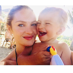 """Candice Swanepoel releases a photo on Instagram with the following caption: """"\ud83d\ude0a\ud83d\ude04Felicidade da mam\u00e3e"""". Photo Credit: Instagram *** No USA Distribution *** For Editorial Use Only *** Not to be Published in Books or Photo Books ***  Please note: Fees charged by the agency are for the agency's services only, and do not, nor are they intended to, convey to the user any ownership of Copyright or License in the material. The agency does not claim any ownership including but not limited to Copyright or License in the attached material. By publishing this material you expressly agree to indemnify and to hold the agency and its directors, shareholders and employees harmless from any loss, claims, damages, demands, expenses (including legal fees), or any causes of action or allegation against the agency arising out of or connected in any way with publication of the material."""