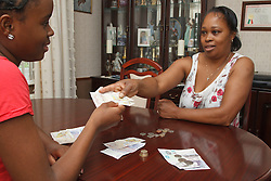 Mother giving daughter money. Cleared for Mental Health issues.