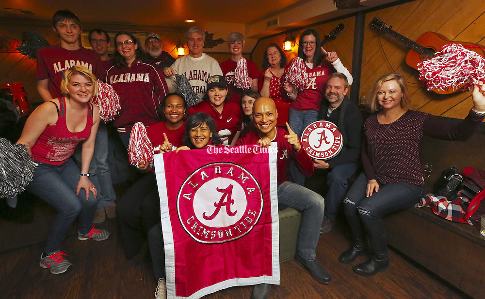 Alabama fans gather in Belltown, Monday, Dec. 19, 2016, in Seattle, for a pre-Peach Bowl portrait at the Belltown Pub, where many will watch the game against the University of Washington. <br /> <br /> Ken Lambert / The Seattle Times
