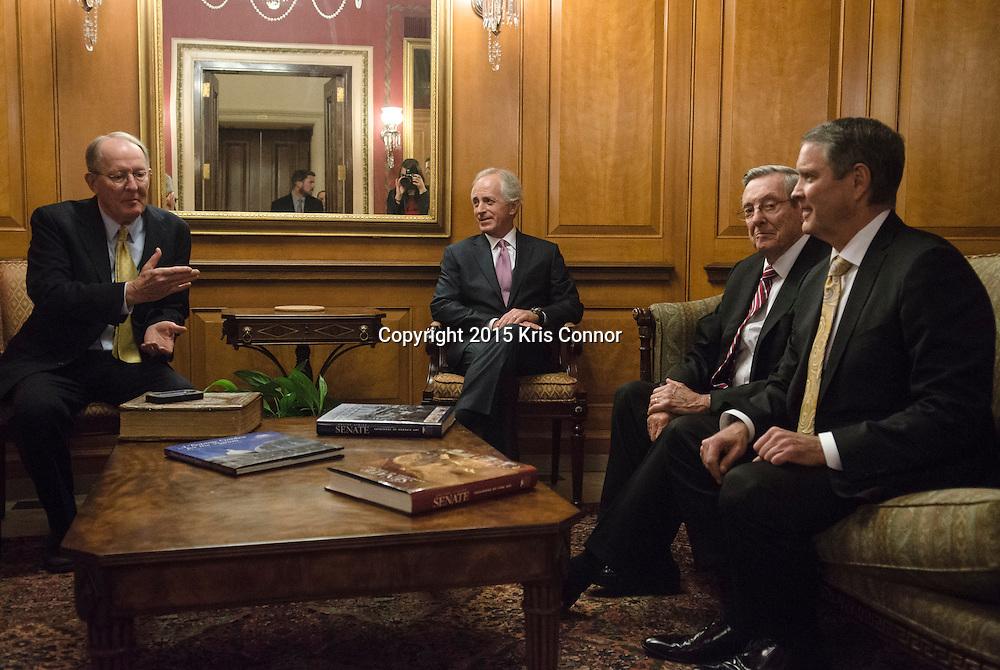Senators Alexander Lamar(R-TN) and Bob Corker(R-TN) speak with former Senators Bill Brock(R-TN) and Bill Frist(R-TN) outside of the Senate Dining Room before having lunch in the U.S. Capitol on January 6, 2015 in Washington DC. Photo by Kris Connor.