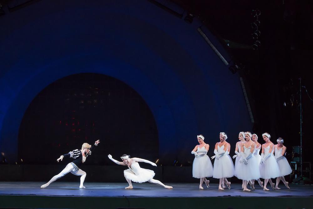 Siegfreid and Odette dance as the other swans look on in Les Ballets Trockadero de Monte Carlo's production of Swan Lake, part of Celebrate Brooklyn, in Prospect Park.