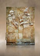 Stone relief sculptured panel of Saron II and a dignitary. Facade L. Inv AO 19873-4 from Dur Sharrukin the palace of Assyrian king Sargon II at Khorsabad, 713-706 BC.  Louvre Museum Room 4 , Paris .<br /> <br /> If you prefer to buy from our ALAMY PHOTO LIBRARY  Collection visit : https://www.alamy.com/portfolio/paul-williams-funkystock/ancient-assyria-antiquities.html  Refine search by adding background colour, place, subject, museum etc into the LOWER SEARCH WITHIN GALLERY box to <br /> <br /> Visit our ANCIENT WORLD PHOTO COLLECTIONS for more photos to download or buy as wall art prints https://funkystock.photoshelter.com/gallery-collection/Ancient-World-Art-Antiquities-Historic-Sites-Pictures-Images-of/C00006u26yqSkDOM