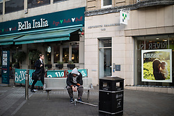 © Licensed to London News Pictures . 24/10/2018. Leeds , UK . A man who appears to be suffering the effects of Spice , sits slumped on a bench on Briggate , in Leeds City Centre . At least six people sleeping rough have died in the Metropolitan Borough of the City of Leeds since March 2017 and West Yorkshire Police say they responded to 66 reported cases of people suffering the effects of Spice in July 2018 , a large increase on previous months . Photo credit : Joel Goodman/LNP