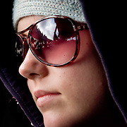 Young woman in sunglasses and hood (, Laos - Nov. 2008) (Image ID: 081126-0813271a)