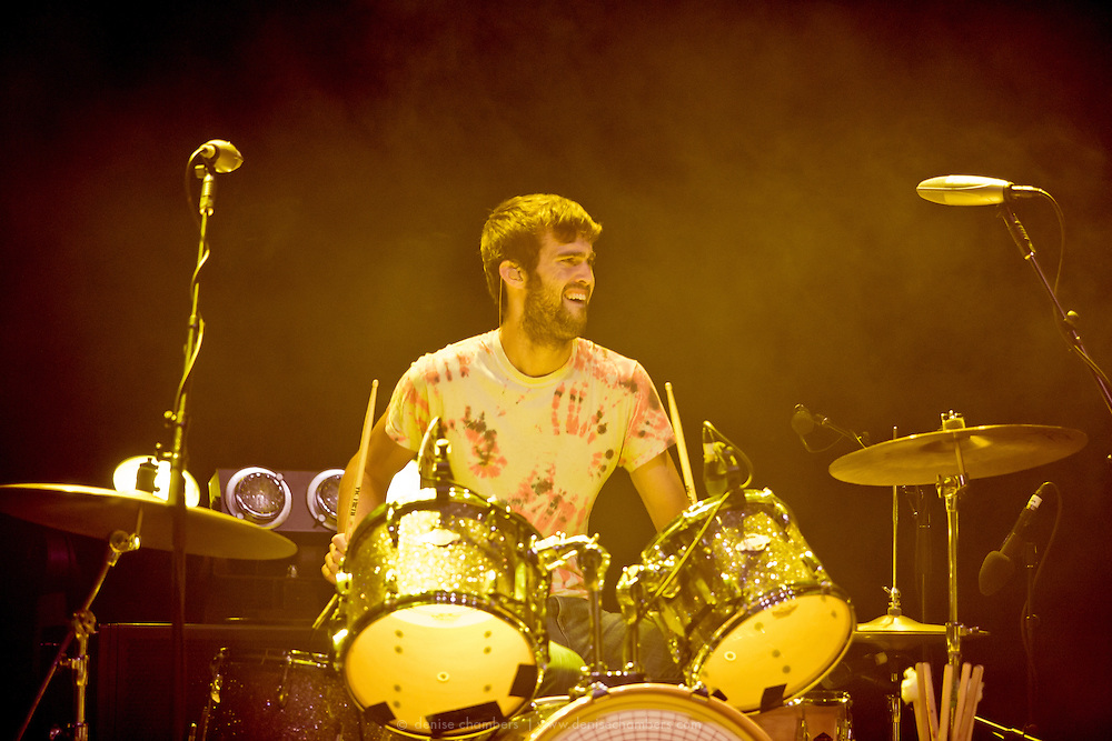"""Chris Tomson of Vampire Weekend perform on September 3, 2010 in support of """"Contra"""" at Red Rocks Amphitheater in Morrison, Colorado."""