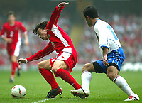 Photo: Scott Heavey<br />Wales V Azerbaijan. 29/03/03.<br />Simon Davies tangles with Emin Imamaliyev during this afternoons Euro 2004 Group 9 qualifying match at the Millenium stadium in Cardiff.