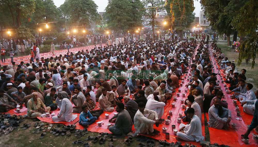 May 28, 2017 - Lahore, Punjab, Pakistan - Pakistani volunteers distributing Iftar foods before breaking their fast on the first day of the holy month of Ramzan-ul-mubarak food among the faithful muslims in Lahore on MAy 28, 2017. Muslims around the world celebrate the holy month of Ramzan by praying during the night time and abstaining from eating, drinking, and sexual acts daily between sunrise and sunset. Ramzan is the ninth month in the Islamic calendar and it is believed that the Koran's first verse was revealed during its last 10 nights. (Credit Image: © Rana Sajid Hussain/Pacific Press via ZUMA Wire)
