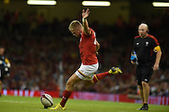 Gareth Anscombe of Wales kicks a conversion. Wales v Ireland rugby union international, RWC warm up friendly match at the Millennium Stadium in Cardiff, South Wales on Saturday 8th August  2015.<br /> pic by Andrew Orchard, Andrew Orchard sports photography.
