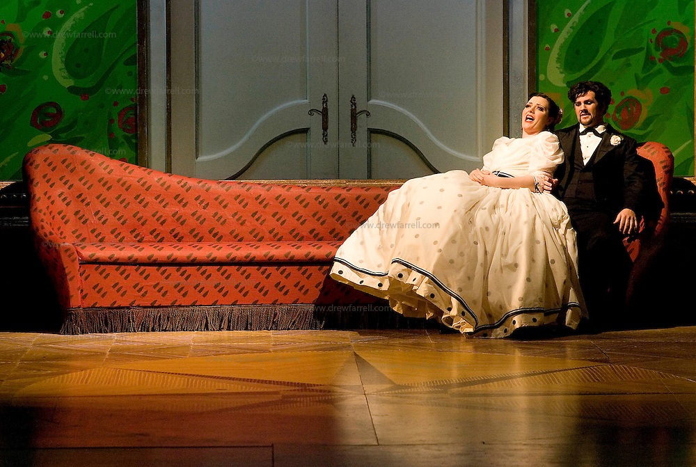 Picture shows :  Kate Valentine (white dress) as Karolina, with David Pomeroy as Ladislav Podhajsky...Picture  ©  Drew Farrell Tel : 07721 ?735041.THE TWO WIDOWS by  Smetana.A SCOTTISH OPERA AND EDINBURGH INTERNATIONAL FESTIVAL CO-PRODUCTION.Premiering at the Edinburgh International Festival, this brand new production stars Scottish soprano Kate Valentine and internationally renowned mezzo Jane Irwin..The directorial partnership between Tobias Hoheisel and Imogen Kogge transforms this delicate comedy into something that digs deeper without losing its inherent charm. Francesco Corti conducts this, his first production as Music Director of Scottish Opera...Kate Valentine as Karolina Záleská.Jane Irwin as Ane?ka Miletinská?Nicholas Folwell as Mumlal?David Pomeroy as Ladislav Podhajsky?Ben Johnson as Toník, a peasant?Rebecca Ryan as Lidka, a maid.?Conductor..Francesco Corti.Directors ..         Tobias Hoheisel & Imogen Kogge.Designer..         Tobias Hoheisel.Lighting..         Peter Mumford.Choreographer  .Kally Lloyd-Jones.Dramaturg..Micaela von Marcard..Performances :.Edinburgh Festival Theatre?9 ? 11 ? 12  August?Theatre Royal, Glasgow?10 ?  14 ? 17 ? October?Note to Editors:  This image is free to be used editorially in the promotion of Scottish Opera and The Edinburgh International Festival. Without prejudice ALL other licences without prior consent will be deemed a breach of copyright under the 1988. Copyright Design and Patents Act  and will be subject to payment or legal action, where appropriate..Further further information please contact Kerryn Hurley Scottish Opera Press Manager t:   0141 242 0511. Or contact The Edinburgh International Festival Press Office  +44 (0)131 473 2020.