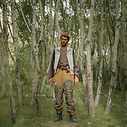 This man padded his pants for cutting grass, a job that is done kneeling. The land is harsh and every blade of grass is cut to use for fodder. The trees here have been planted by villagers to be used for fuel or to build houses. The traditional life of the Wakhi people, in the Wakhan corridor, amongst the Pamir mountains.