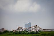View of Long Bien bridge from Long Bien Island with modern high-rises towering behind it, Hanoi, Vietnam, Southeast Asia