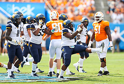 Sep 1, 2018; Charlotte, NC, USA; West Virginia Mountaineers defensive lineman Darius Stills (56) celebrates after a tackle against the Tennessee Volunteers during the first quarter at Bank of America Stadium. Mandatory Credit: Ben Queen-USA TODAY Sports