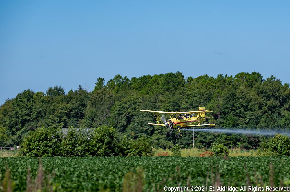 Crop duster spraying fields in rural South Carolina in a bi-plane. Image taken by Ed Aldridge with a NIKON Z 6_2 and NIKKOR Z 70-200mm f/2.8 VR S at 200mm, ISO 50, f5.6, 1/320.